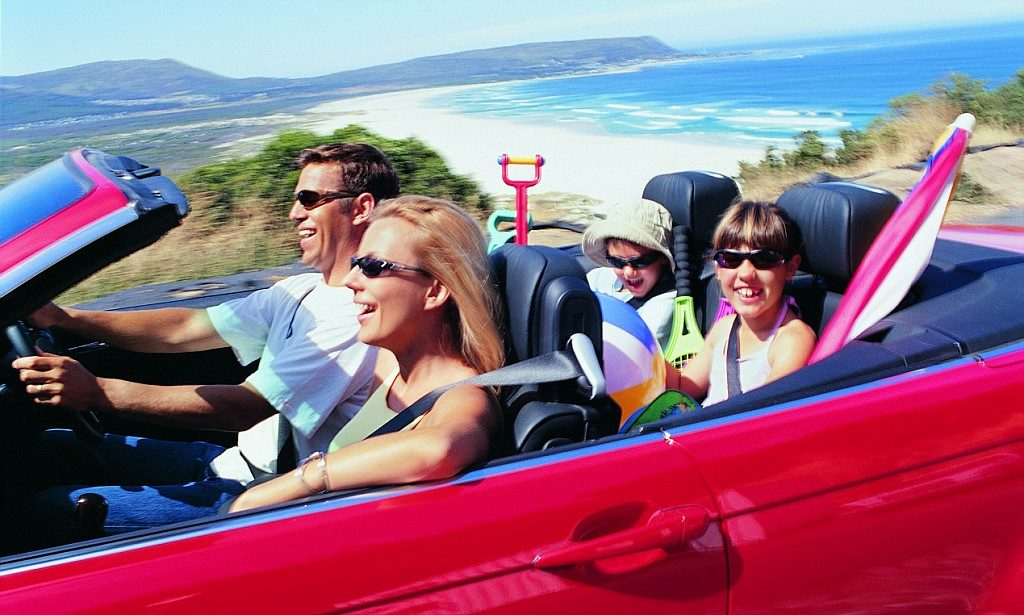 Family of Four Driving to the Seaside in a Convertible --- Image by © Ocean/Corbis